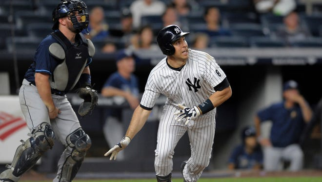 New York Yankees' Mark Teixeira drops his bat after hitting a grand slam as Tampa Bay Rays catcher Bobby Wilson, left, watches during the fourth inning of a baseball game Friday, Sept. 9, 2016, at Yankee Stadium in New York.