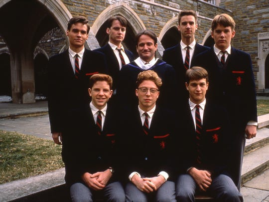 "Robin Williams, back row center, in 1989's ""Dead Poets Society."""