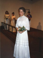 Ione modeling her mother's 1907 graduation dress from Castleton Normal School. Photo taken in 1993.