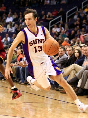 Then-Phoenix Suns guard Steve Nash drives against the Cleveland Cavaliers at US Airways in Phoenix on Jan. 12, 2011.