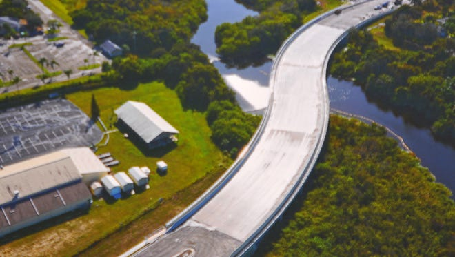 The Apollo Boulevard bridge over the Eau Gallie River in Melbourne opened to traffic Wednesday morning.