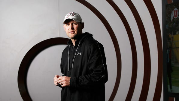 In this Jan. 20, 2017, photo, University of Utah NCAA college football offensive coordinator Troy Taylor poses for a portrait in Salt Lake City. Utah opens spring practices on Thursday, March 9, 2017,  with a new offensive coordinator, Troy Taylor. The Utes have brought in a passing game specialist to run the offense after being inept in that phase since joining the Pac-12. (Jeffrey D. Allred/The Deseret News via AP)