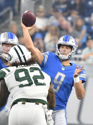 Lions quarterback Matthew Stafford throws In the first quarter against the Jets.