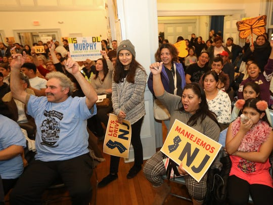 Elizabeth Roque (seated, front row, right arm raised), of Mexico was one of more than 200 people who gathered at Snyder Academy in Elizabeth, Thursday, January 11, 2018 to rally for undocumented people in New Jersey to have the right to obtain a drivers license.  Roque is an undocumented person living in New Jersey who would potentially be able to obtain a license. Outgoing governor, Chris Christie has spoken against it however, Phil Murphy, who will become governor next week, has different views than Christie on the subject.  If New Jersey passes the legislation it will become the 13th state to do so.  Washington D.C. also has similar legislation.