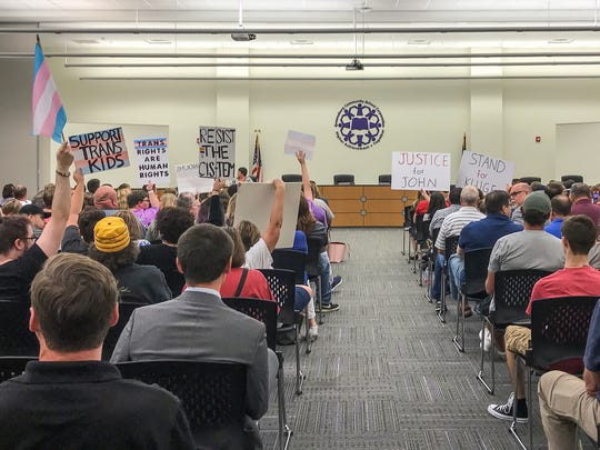 Supporters of embattled teacher John Kluge and those standing by transgender students attend a school board meeting at Brownsburg Community School's Central Office on June 11, 2018.