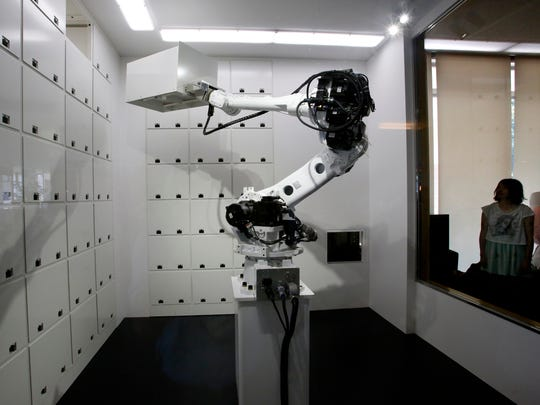 A giant robotic arm, usually seen in manufacturing,