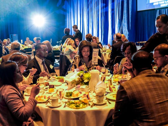 People enjoy their meal at the third annual Lansing