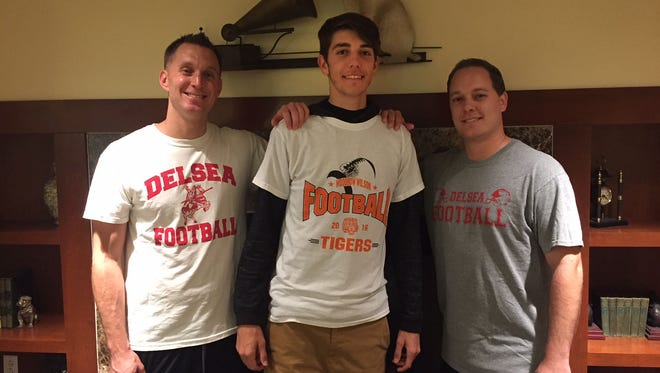 Woodrow Wilson quarterback Nick Kargman, center, learned the game from his cousins, Delsea graduates Mark Kargman, left, and Dave Kargman. Nick leads the Tigers against the Crusaders this Friday night.