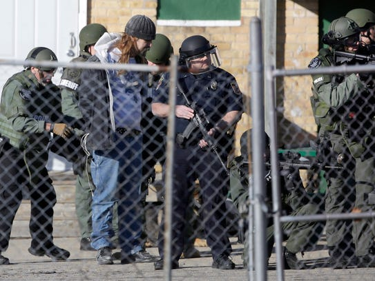 Police arrest Brian T. Flatoff on Dec. 5 after a hostage