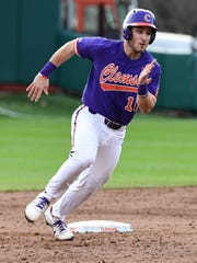 Clemson sophomore catcher Kyle Wilkie (10) rounds second base against William and Mary during the bottom of the third inning on Saturday at Doug Kingsmore Stadium in Clemson.