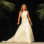 A model shows off a wedding gown during the 2014 American Bridal Show at Lake Terrace Convention Center. Nearly 30 vendors are expected to showcase their products and services at this year's show set for 1-4 p.m. Sunday at the convention center.