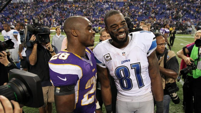 Adrian Peterson, left, and Calvin Johnson after a game in 2012.