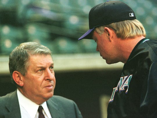 Jerry Colangelo, managing general partner of the Arizona Diamondbacks, left, talks to team manager Buck Showalter during a Diamondbacks workout at the Bank One Ballpark (BOB) in Phoenix, Arizona, October 4. The Diamondbacks won the National League West championship and begin post season play in BOB Tuesday. The Diamondbacks are an expansion team in their second season of play. Last year they had the worst record in their division. The team's turnaround from worst to first is the fastest in Major League Baseball history. They are the first expansion team to make the playoffs in only two seasons of play.