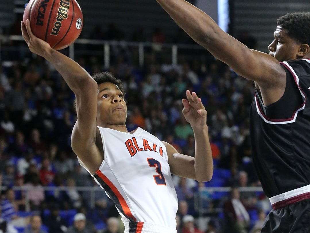 Blackman junior Donovan Sims elevates for a shot during Friday's semifinal loss to Memphis East.
