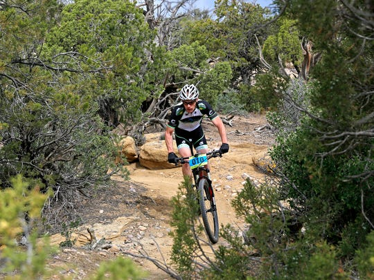 Riders make their way along the trail during last year's Alien Run Mountain Bike competition on May 3 at Hart Canyon in Aztec.