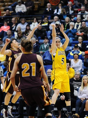 Augustana's Sophie Kenney (5) takes a shot during a game against Minnesota Duluth on Wednesday, Feb. 25, 2015, at the Sioux Falls Arena in Sioux Falls, S.D.
