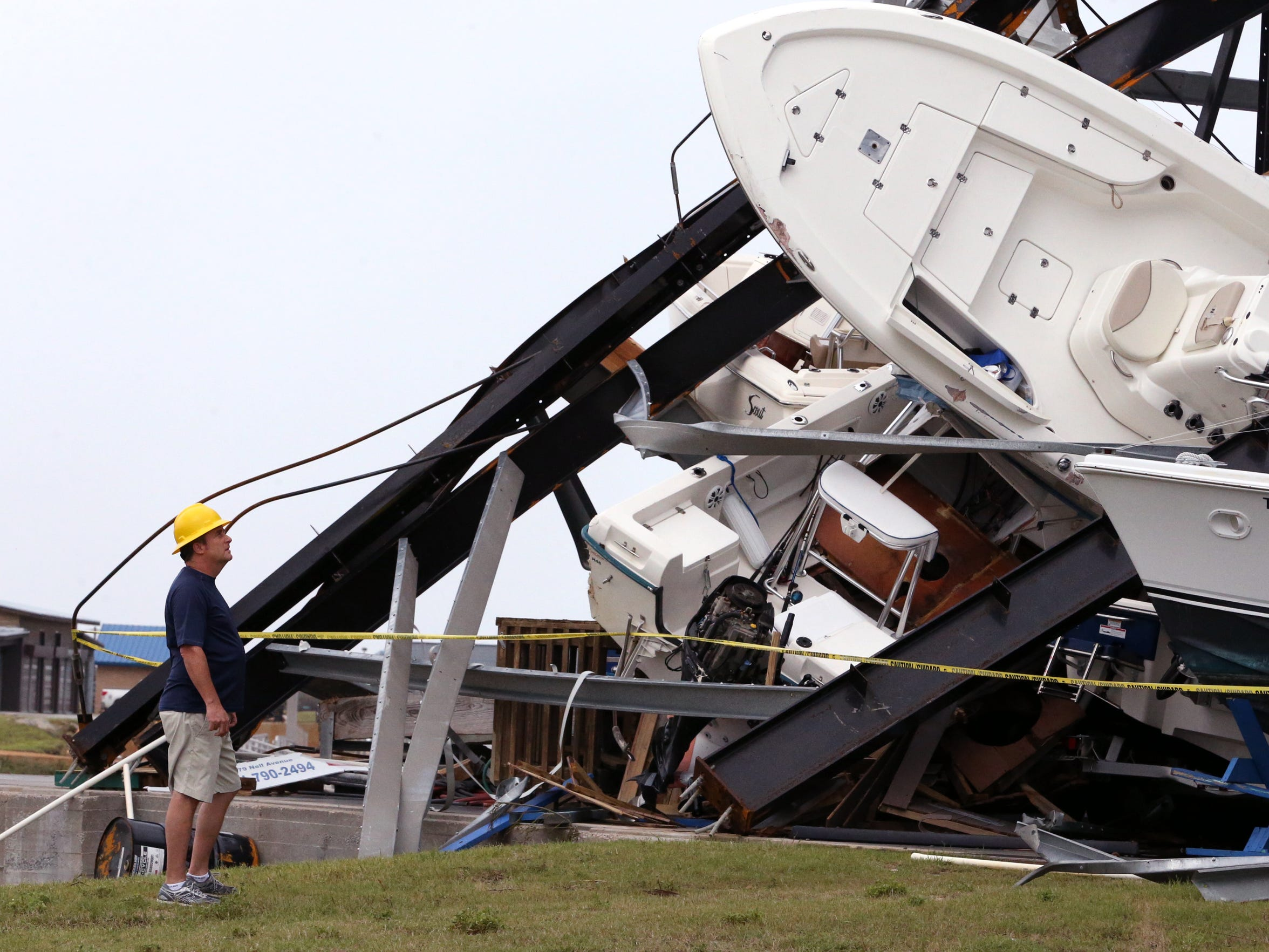 """Roger Braugh Jr. searches for his boat is this boat storage facility in Cove Harbor in Rockport, TX, on Sunday, August 27, 2017, which sustained considerable damage due to Hurricane Harvey. """"I've got one chance,"""" he said. """"The boat used to be here. I see one with the right motor.""""(Corpus Christi Caller-Times, Rachel Denny Clow)"""