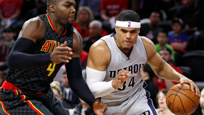Pistons forward Tobias Harris (34) gets defended by Hawks forward Paul Millsap (4) during the first quarter at The Palace of Auburn Hills Saturday.