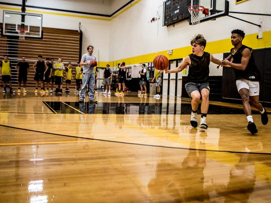 The Watkins basketball team runs drills to get ready for the start of their new season.
