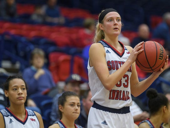 USI's Kaydie Grooms (33) looks for a teammate to pass