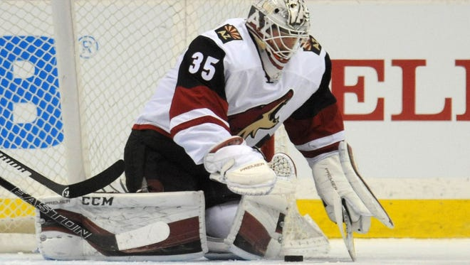 Jan. 25, 2016; St. Paul, Minn.;  Arizona Coyotes goalie Louis Domingue makes a save during the first period against the Minnesota Wild at Xcel Energy Center.
