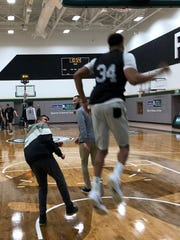 Re-enacting one of his jaw-dropping dunks, Giannis Antetokounmp hoops it up with 15-year-old Dimitris Zamanis of Greece. The Milwaukee Bucks and Make-A-Wish teamed up to give Zamanis a day with the Bucks superstar.