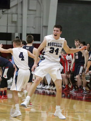 Roncalli's Josh Koss (4) and Ian Behringer (34) celebrate their 60-50 win over The Prairie School on Saturday at Waukesha South High School.