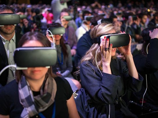 A hall full of people sample Oculus Rift, the Facebook-owned