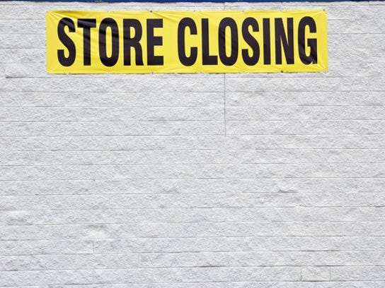 """Picture of building with a """"store closing"""" sign."""