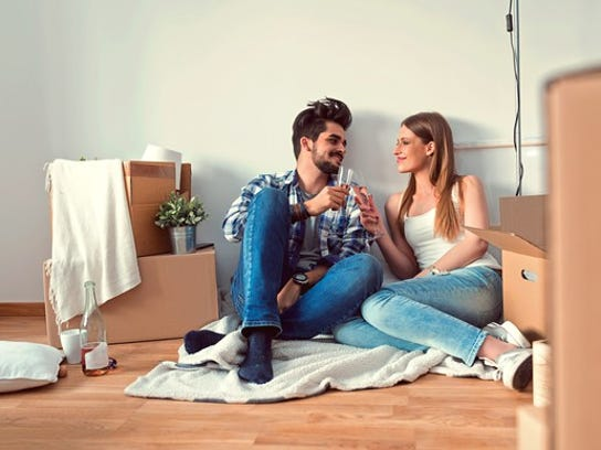 Young couple with boxes, moving into a new place