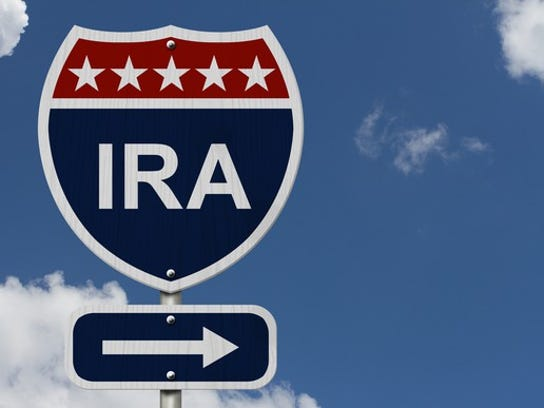 """An interstate-style road sign that reads """"IRA,"""" with a cloudy sky in the background."""