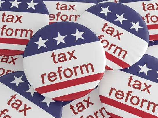 """Stack of buttons that say """"tax reform."""""""