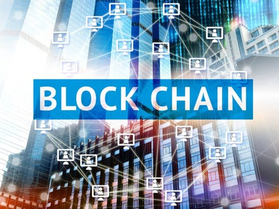 "Reads ""Blockchain"" across the picture with computer graphics in background."