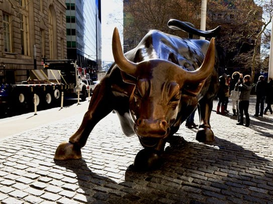 """""""Charging Bull,"""" a sculpture on Wall Street in New York City. The easy money, artificially low interest rates, globalization and low inflation have fed the equity bull market; all of this is now in flux."""