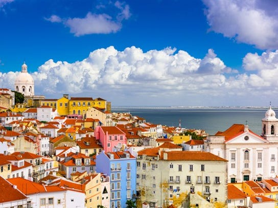 Lisbon, Portugal, cityscape, with pastel buildings and the sea