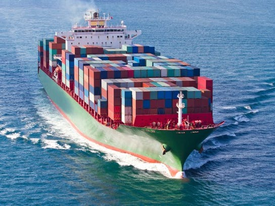 A container ship with a deck stacked full of shipping containers at sea