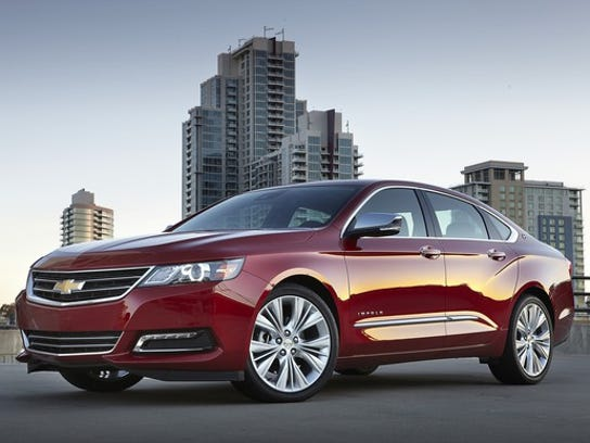 A red 2018 Chevrolet Impala, a full-size sedan.