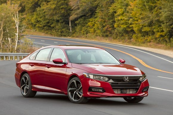 A Red 2018 Honda Accord, A Midsize Sedan With A Hatchback Like Roofline,
