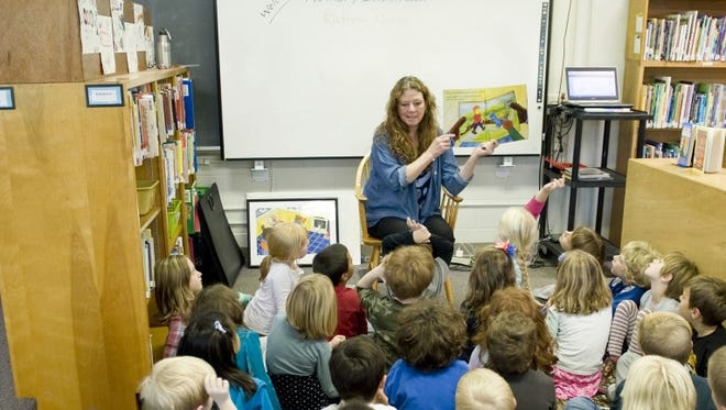 Katrina Morse is shown reading to a class at Caroline Elementary School.