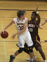 Indianola senior Graham Sandquist tries to slip a pass behind Ankeny senior Chris McLeod. Ankeny beat Indianola 70-52 in Indianola on Dec. 15.