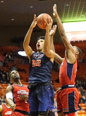 UTEP'S Paul Thomas, 22, rises for a shot against Florida Atlantic Saturday night in the Don Haskins Center.
