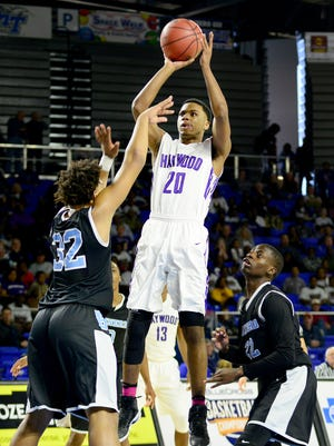 Haywood's Dedric Boyd pulls up for a shot over Brainerd's Jesse Walker during their quarterfinal game, Thursday morning. Boyd's 33 points helped Haywood to a 82-72 victory over Brainerd.