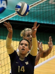 Washington's Jenna Hagglund sets the ball as CSU's Danielle Minch waits at the net during NCAA volleyball action at Moby Arena  Dec. 4, 2009. CSU won the match 3-1.