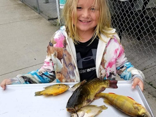 Eight-year-old Amya Lukes caught five different types of fish in the Shanty Days contest, winning three categories.