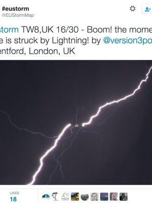 A photo of lightening striking a plane.