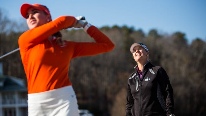 Head coach Kelley Hester watches as junior Marisa Messana drives the ball during Clemson's women's golf practice on Feb. 13.