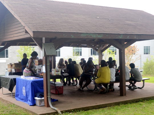 A group of students gathered Saturday at Conger Park to be honored for participating in the Phoenix Curriculum program.