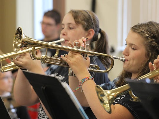 Allison Cotton, 14, Rothschild, right, and Amy Jordan, 15, Kronenwetter, play trumpets during summer jazz band camp.