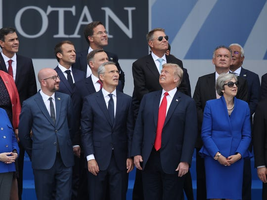 L-R, first row) German Chancellor Angela Merkel, Belgian Prime Minister Charles Michel, NATO Secretary General Jens Stoltenberg, U.S. President Donald Trump and British Prime Minister Theresa May attend the opening ceremony at the 2018 NATO Summit at NATO headquarters on July 11, 2018 in Brussels, Belgium. Leaders from NATO member and partner states are meeting for a two-day summit, which is being overshadowed by strong demands by U.S. President Trump for most NATO member countries to spend more on defense.