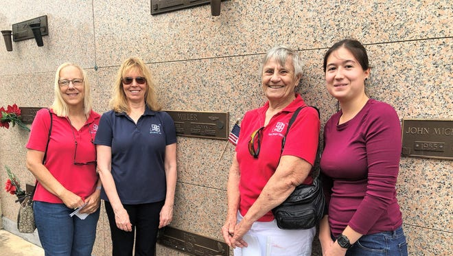 From left, Donna Wilt, Sandy Parks, Bobbi Lasher and Isabel Prado of the Spaceport 99s stand in front of the final resting place of WASP Carolyn Culpeper.